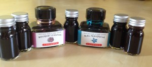 selection of ink bottles, some are tiny vials which are scented ink