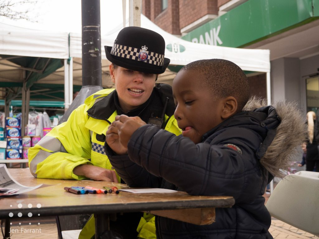 Local police office, Natalie, looks on at the very concentrated drawing!